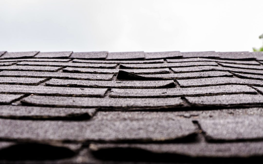 A Roof With Curled Shingles